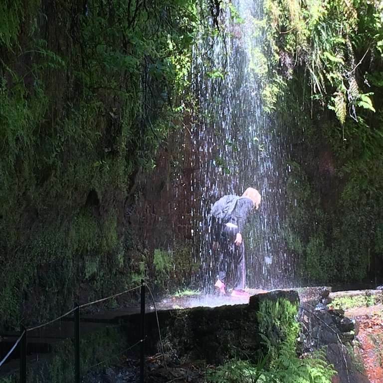Madeira: Levada do Rei: walking under the waterfall