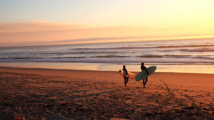 Surfers getting ready for the morning waves near Fishtral beach