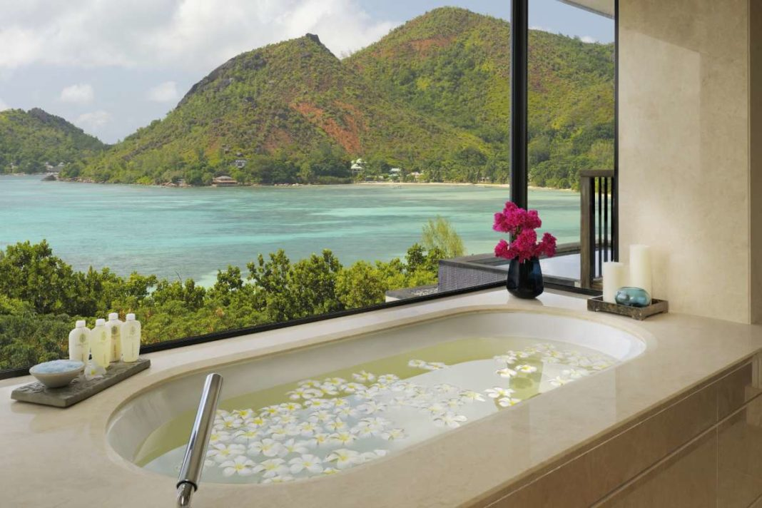 Bath time at Raffles Praslin in the Seychelles with views over the ocean