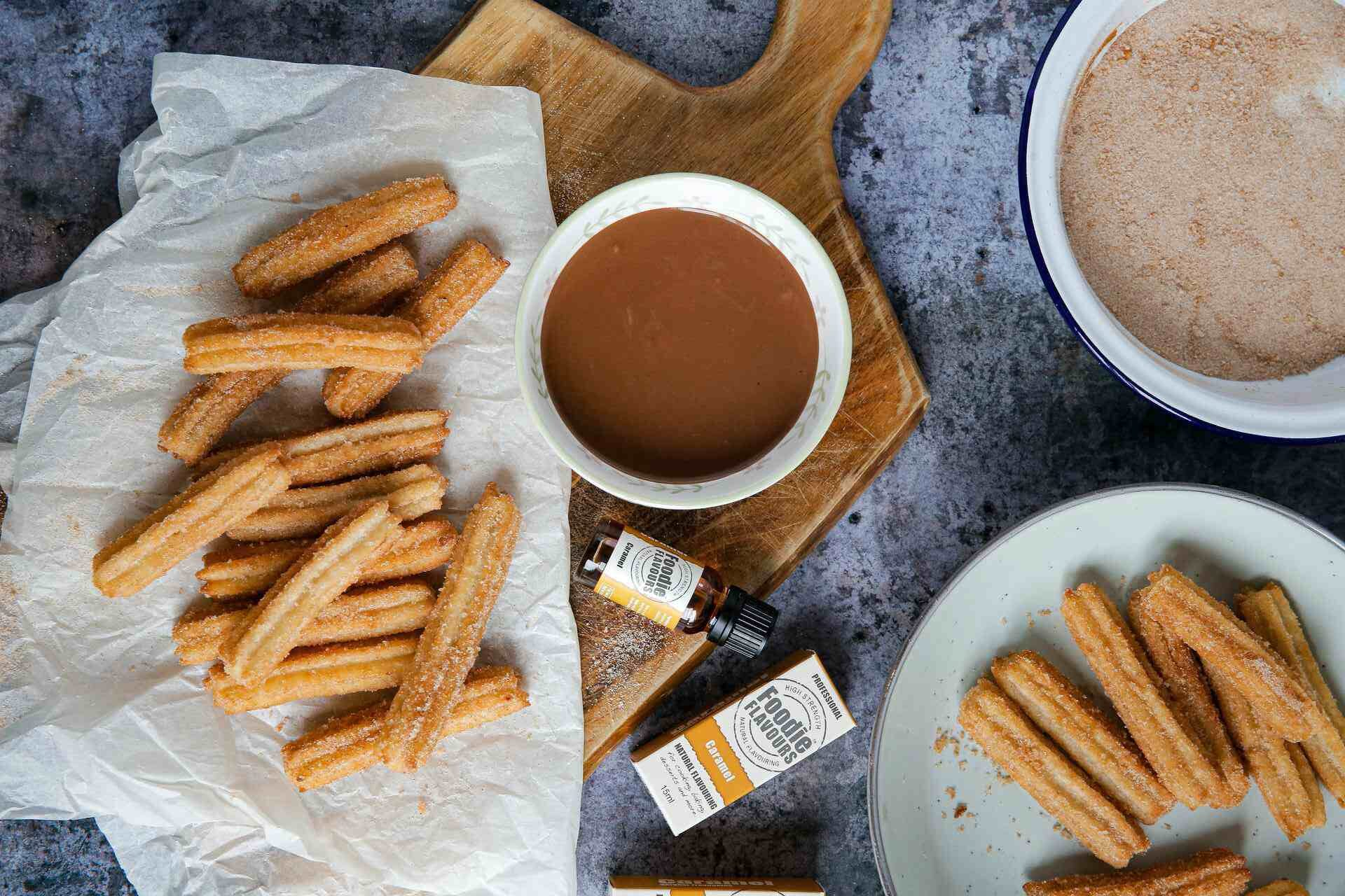 A platter of churros and hot chocolates served with caramel