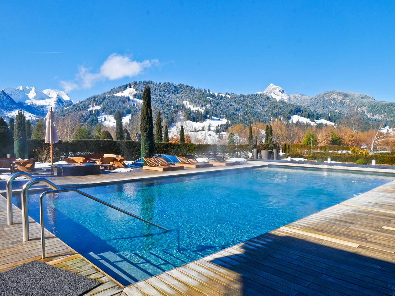 Alpina Gstaad - Outdoor Pool and Mountains