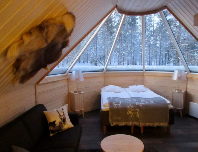 Spend a cosy night in an Aurora Cabin at The Northern Lights Village