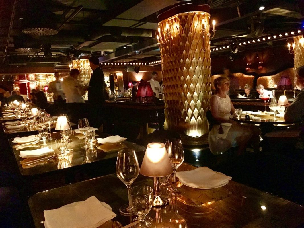 Gold columns in dimly lit dining environment at Club Chinoise, Mayfair
