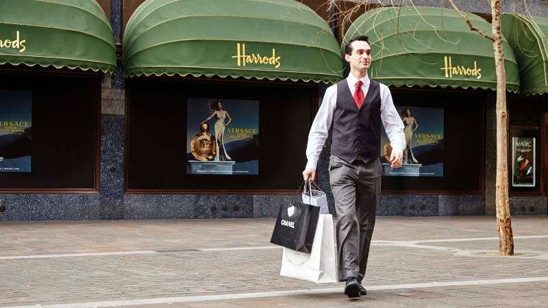 Concierge carrying shopping from Harrods