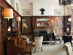 Dunoon sitting room has traditional and antique decorations