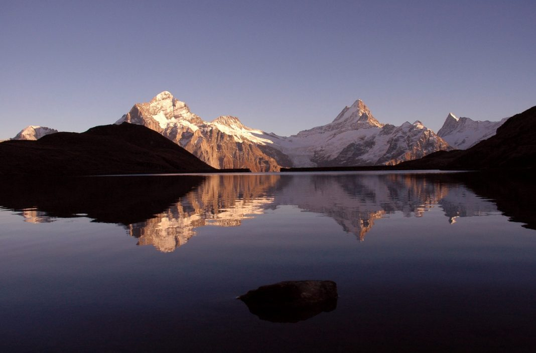 Lake Bachalpsee in the sunset with Wetterhorn and Schreckhorn. c. Jungfrau Region
