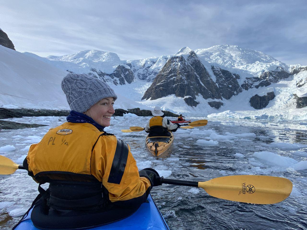 Kayaking through ice in the Antartica