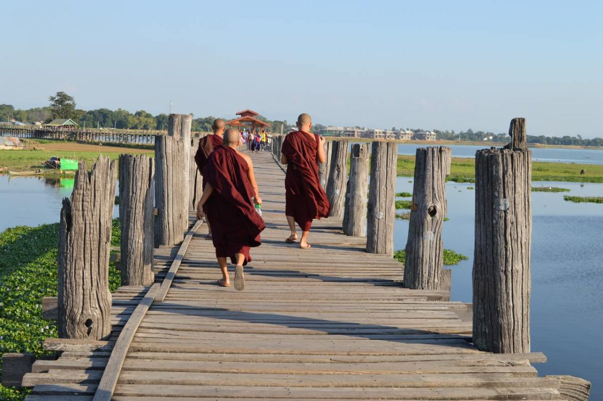 Monks promenading on U Bein Bridge near Mandalay