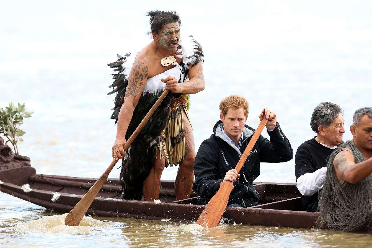 Ned Tapa and Prince Harry paddle a waka down the Whanganui River