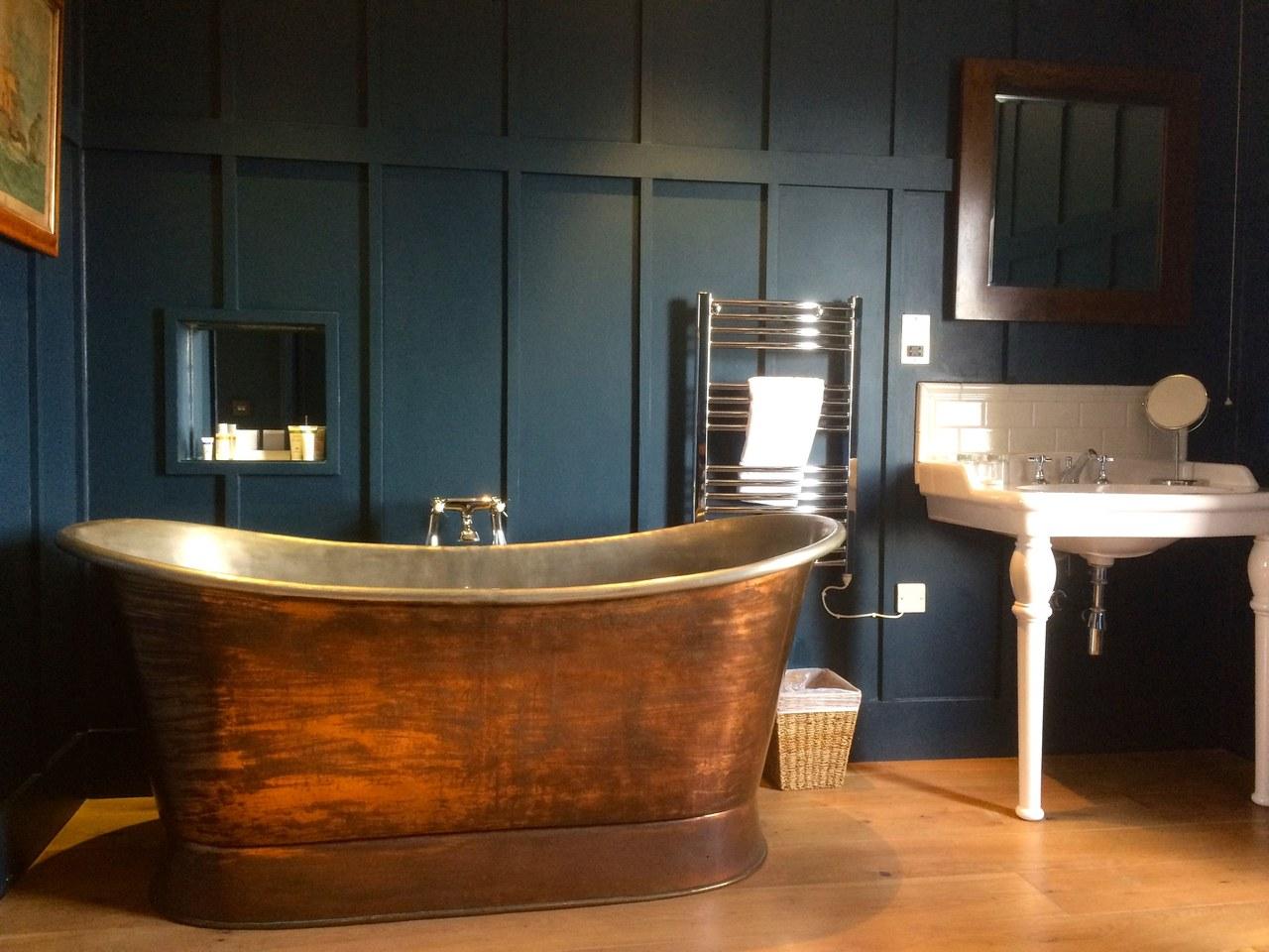Bathroom with copper bath