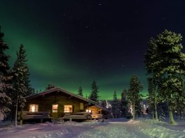 Northern Lights over a cabin in Lapland