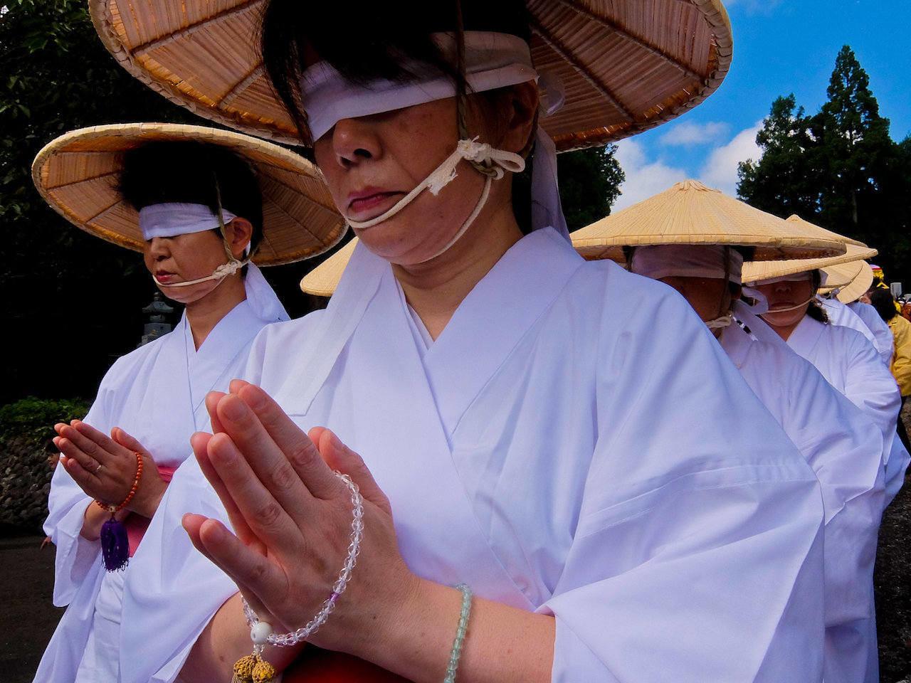 blindfolded women in graveyard