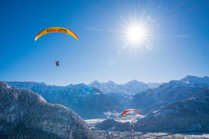 Paragliding over Interlaken during winter