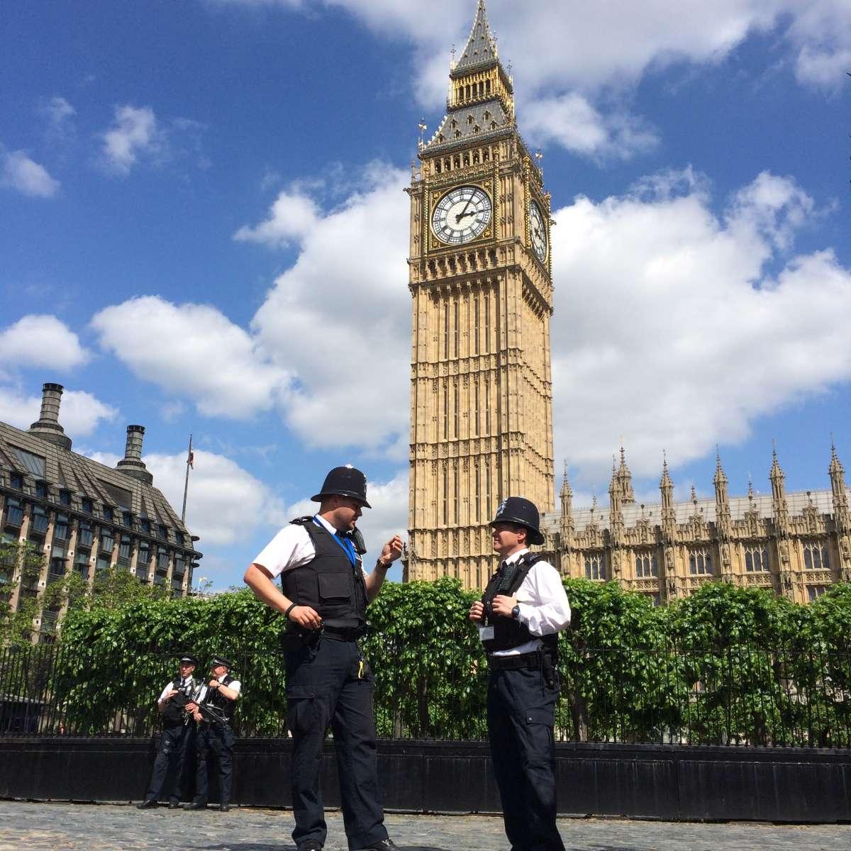 London policemen in front of Big Ben