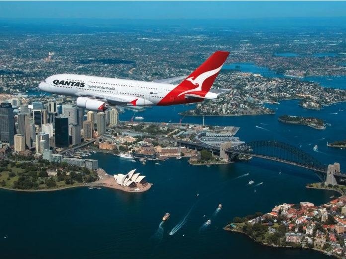 Qantas A380 flying over Sydney Harbor