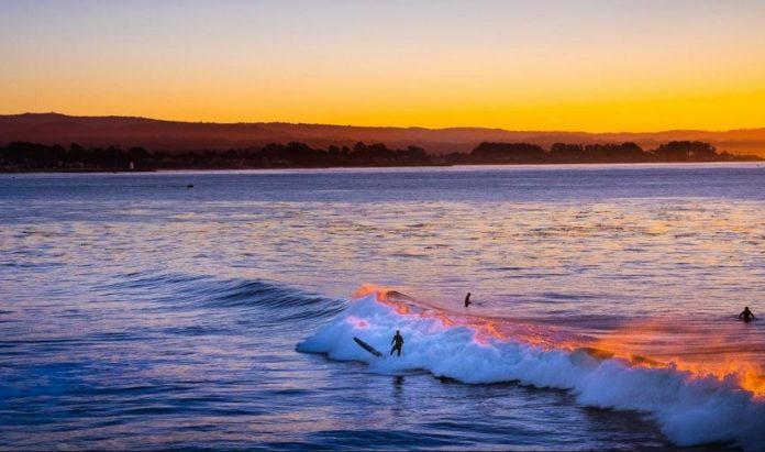 Santa Cruz surfers at sunset