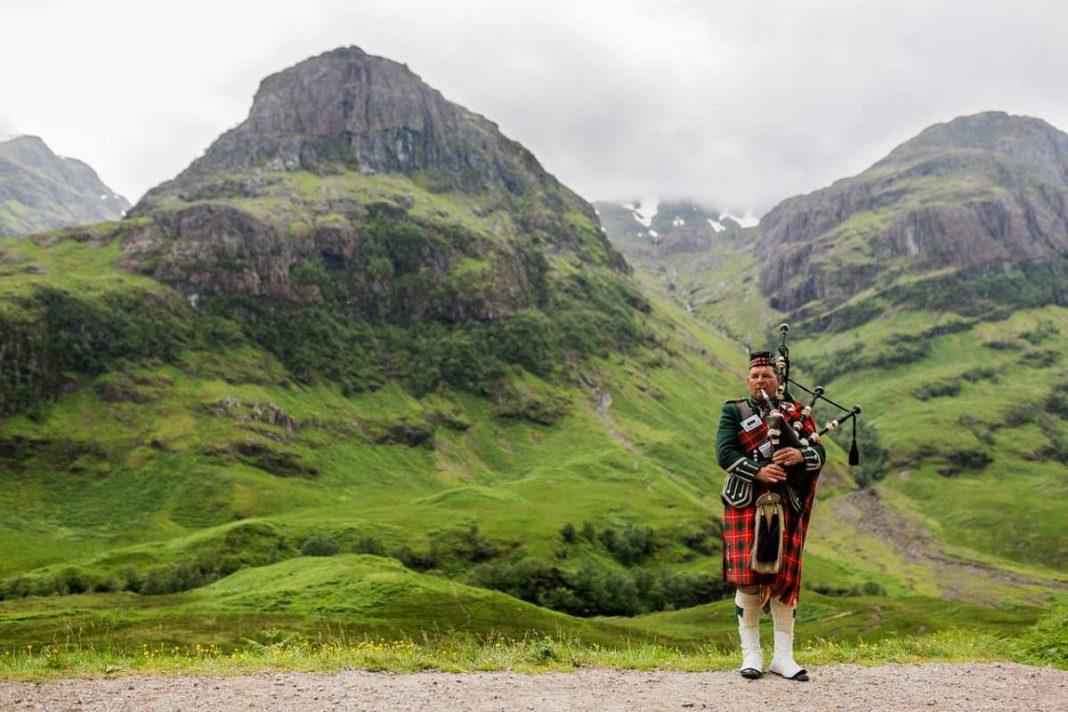Scottish Bagpiper at Glen Coe, Scotland