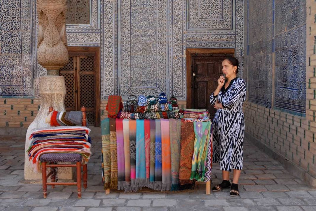 Souvenir seller within the harem at the Ichan Qala in Khiva, Uzbekistan