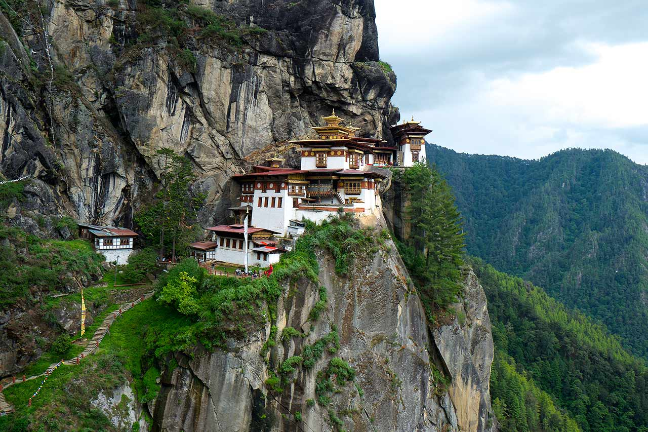 Temples at Tiger's Nest perched precariously on vertiginous cliff