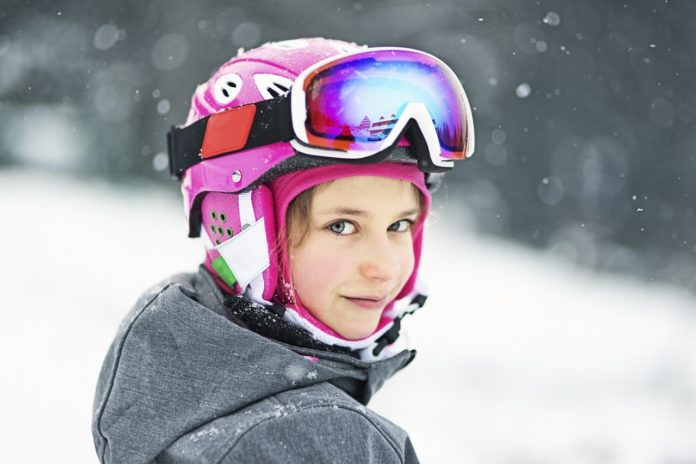 Young girl in ski gear