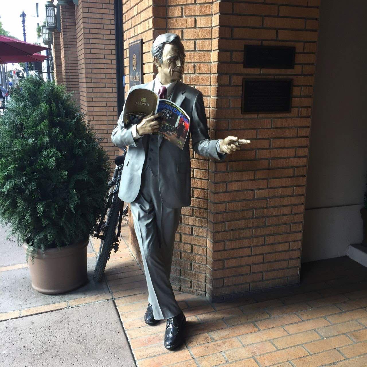 bronze statue That-a-Way by Seward Johnson at the entrance of The Sofia Hotel in San Diego