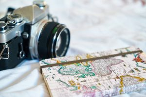 camera and world map notebook