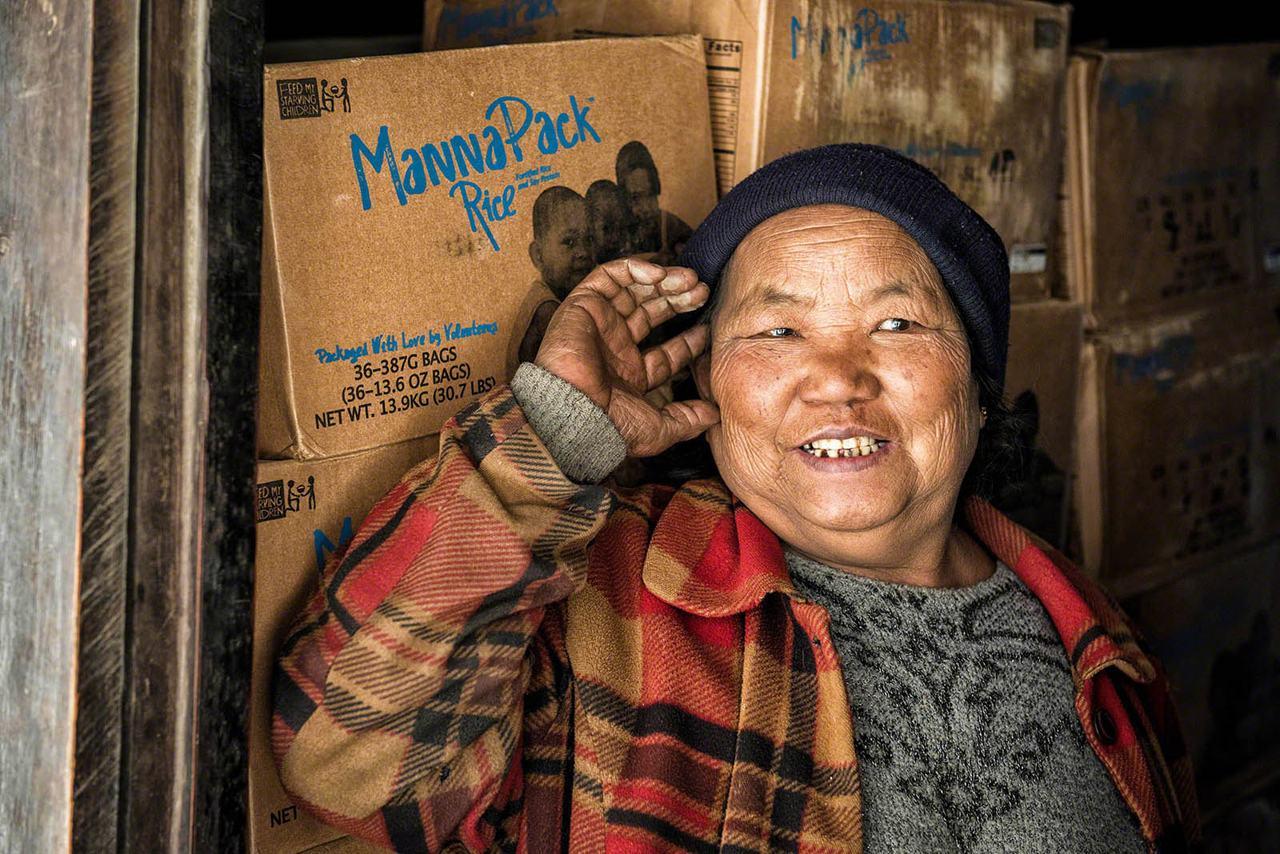Myanmar - woman at the door smiling