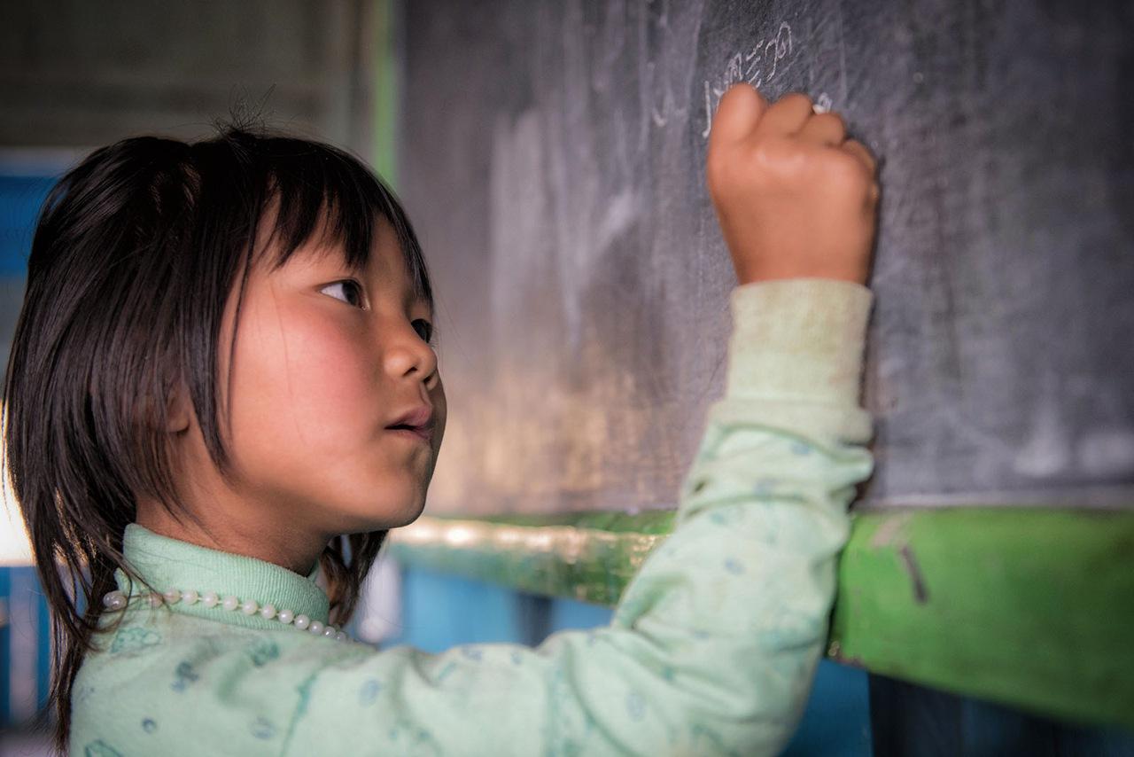 Myanmar - girl at the blackboard