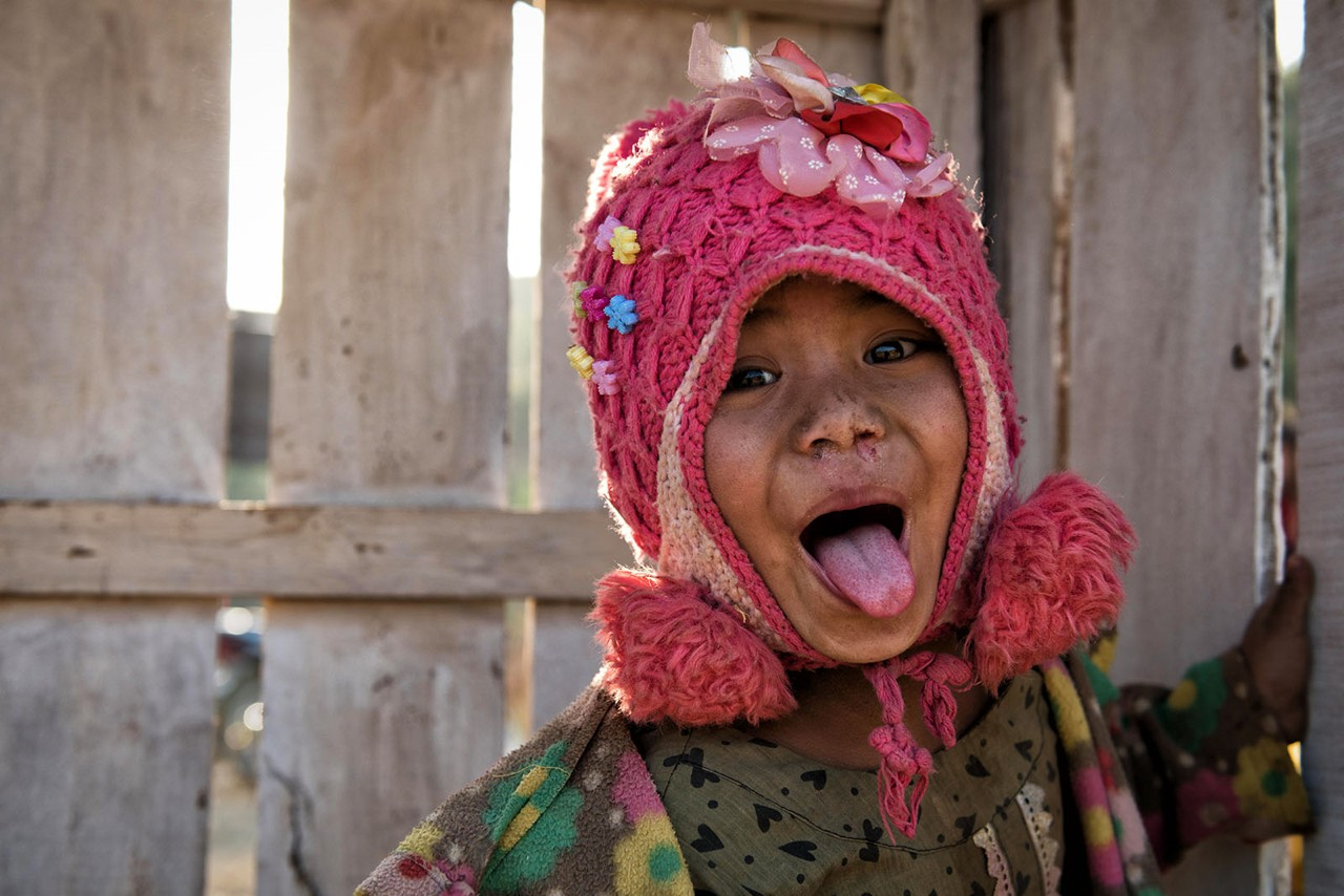 Myanmar - little girl sticking tongue out