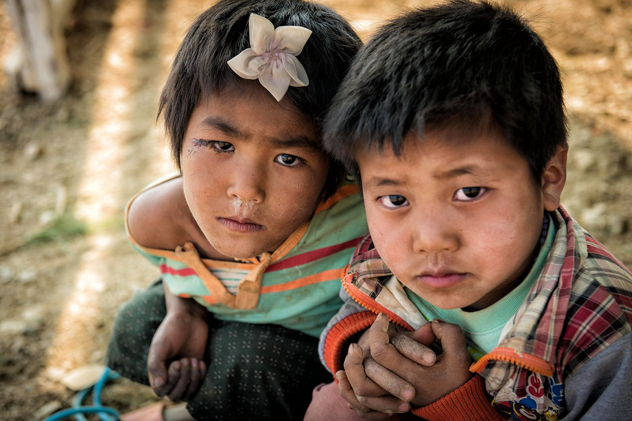 Myanmar - little boy and girl with flower in hair