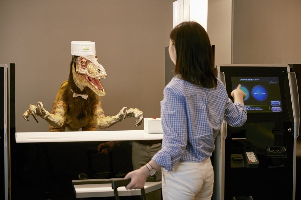 Check in desk serviced by a tri-lingual dinasaur at Henn-na Hotel