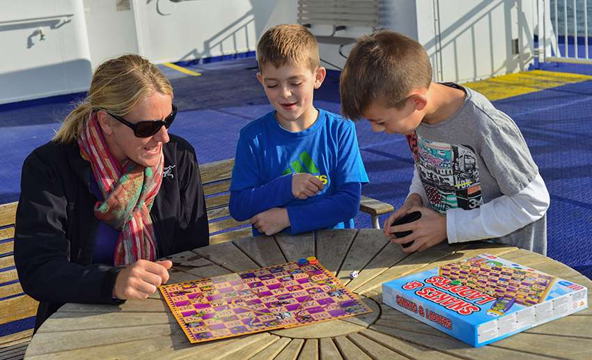 Playing 'Snakes and Ladders' on a ferry