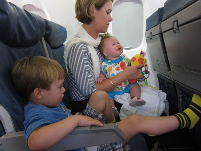 flying with a child and a baby