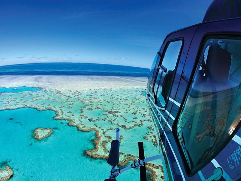Great Australian beach holiday activities - helicopter tour over the Heart Reef
