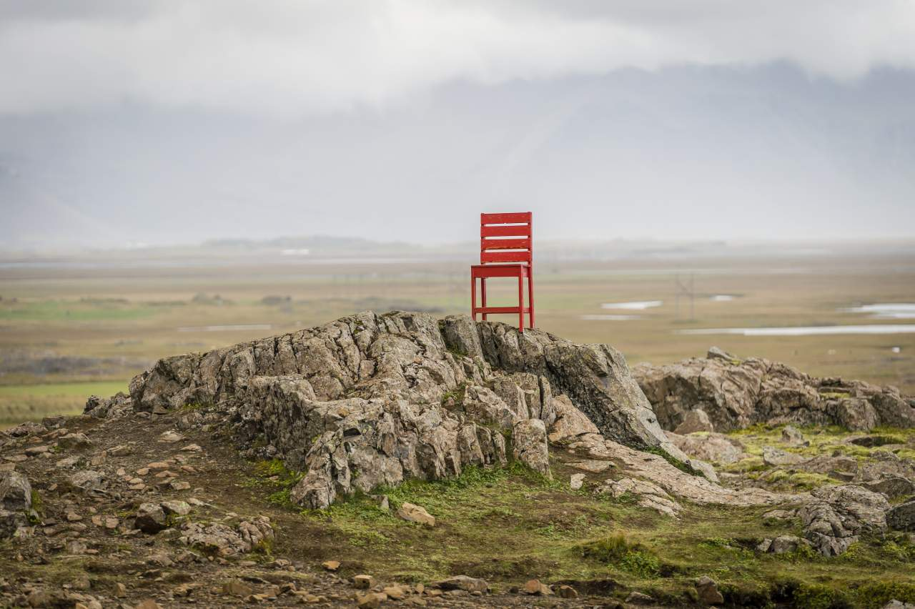 Giant red chair sculpture in Iceland