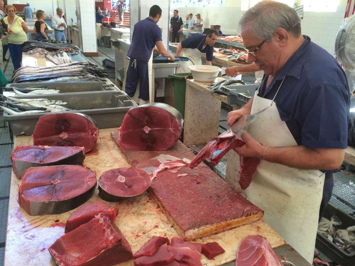 Market in Funchal, Madeira: tuna seller