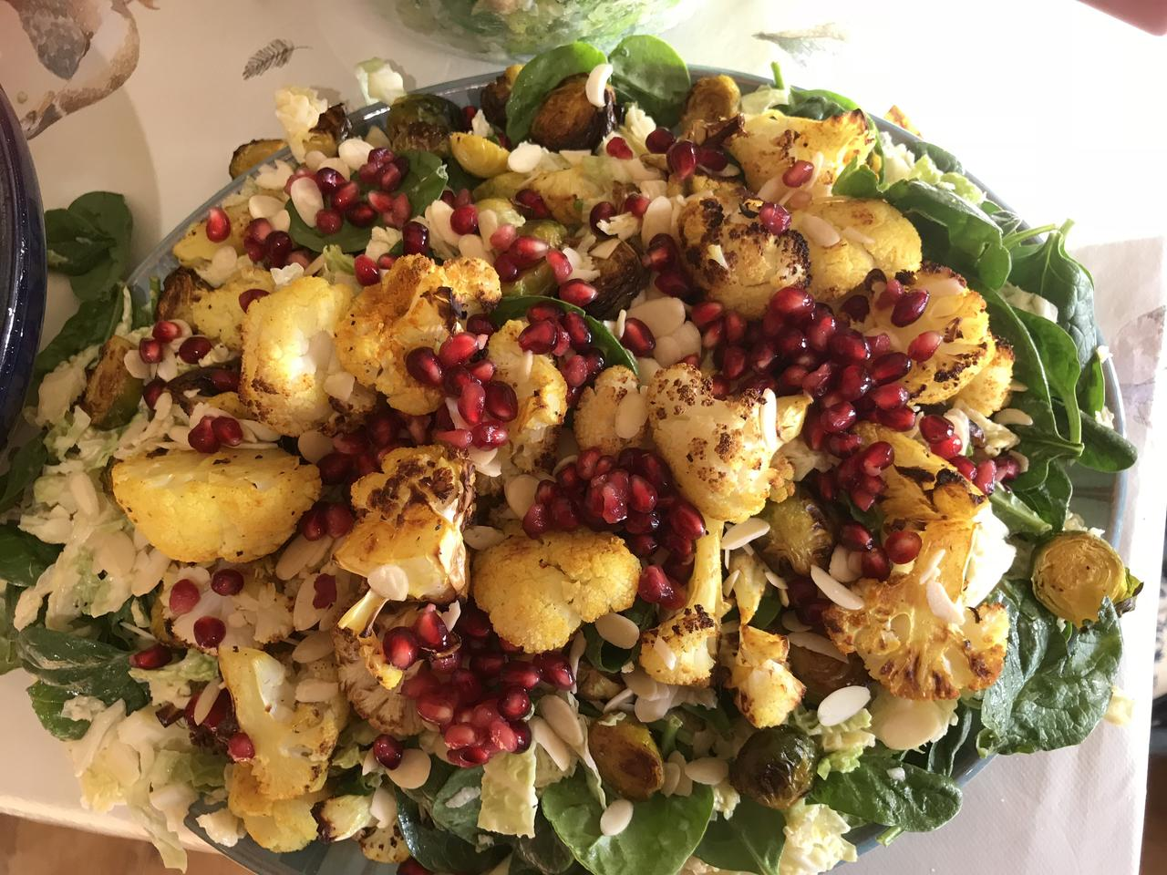 Roasted cauliflower dressed with pomegranate seeds.