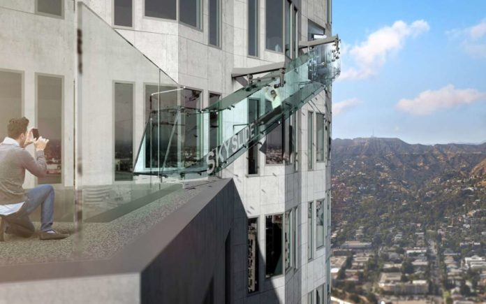 The Skyslide is forty-six feet long, 4 feet wide and made entirely with one and one quarter inches thick glass.
