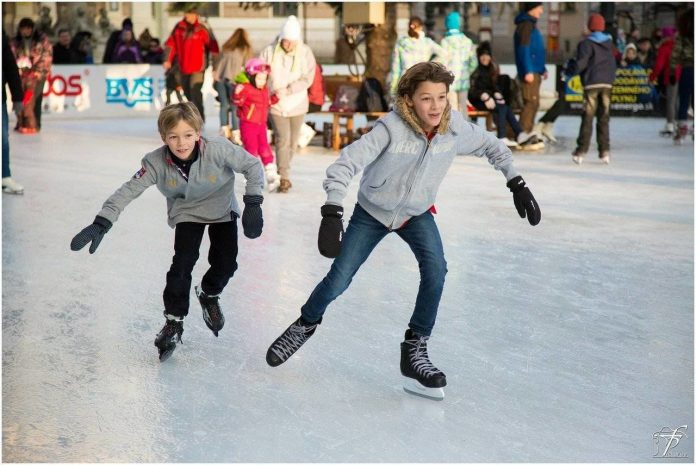 two boys ice skating